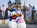 Donald Duck & Daisy in front of Sleeping Beauty Castle