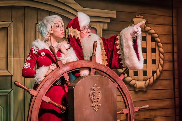 Santa And Mrs Claus At Ship Wheel