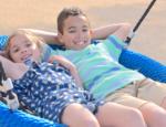 Siblings on Swing